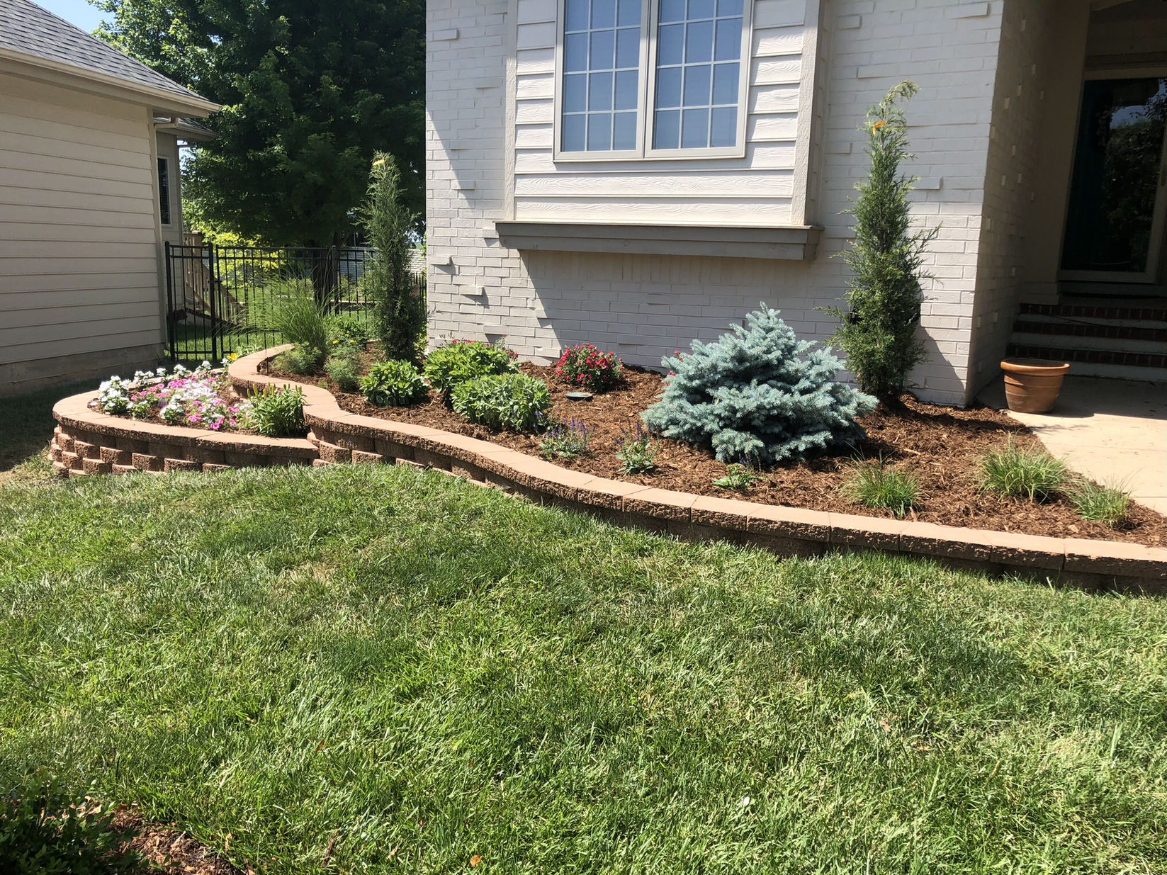 existing home landscaping construction | daniels lawn and
